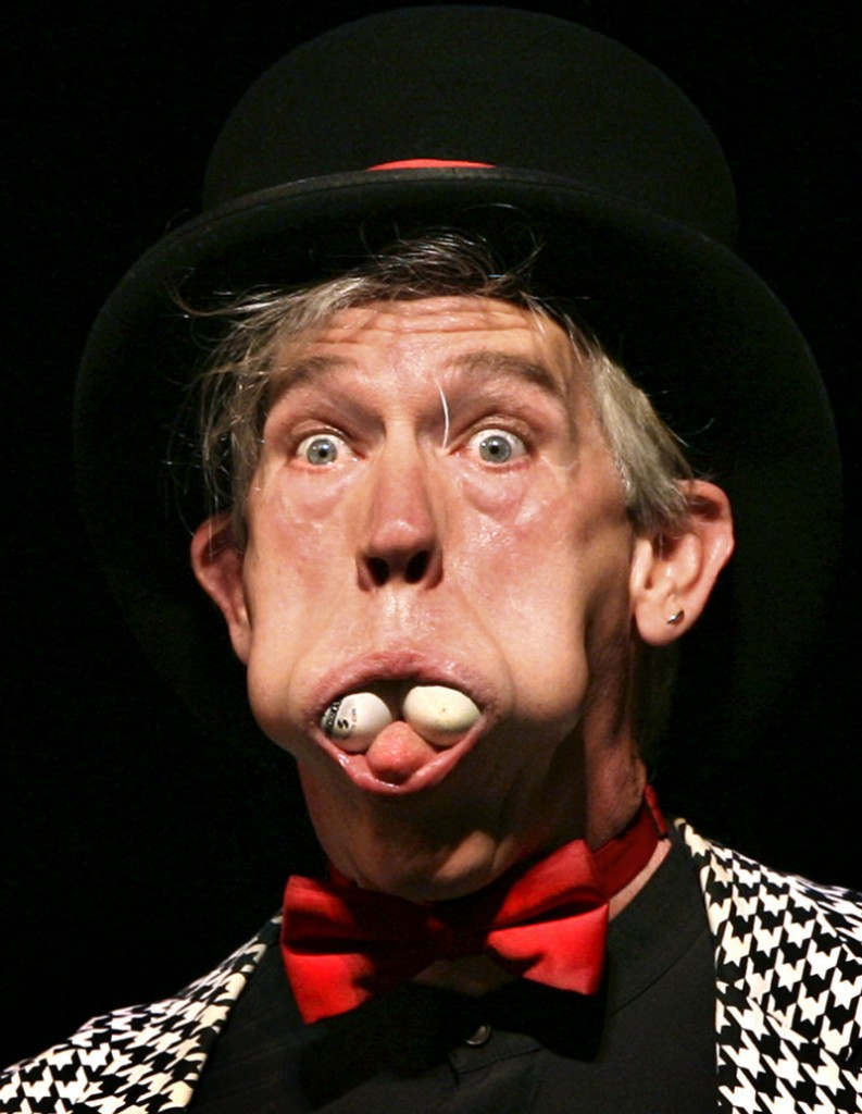 Michael Lane Trautman stuffed ping-pong balls into his mouth during the circus arts performance.