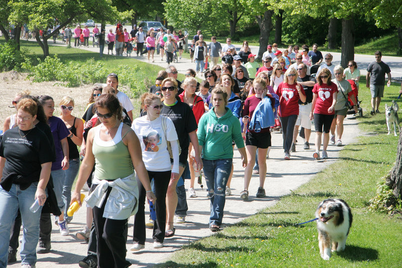 "A long parade of people stretches out along Back Cove in Portland during the Southern Maine Heart Walk on Sunday. Some marchers wore various T-shirts identifying ""teams"" organized to represent the memory of family and friends."