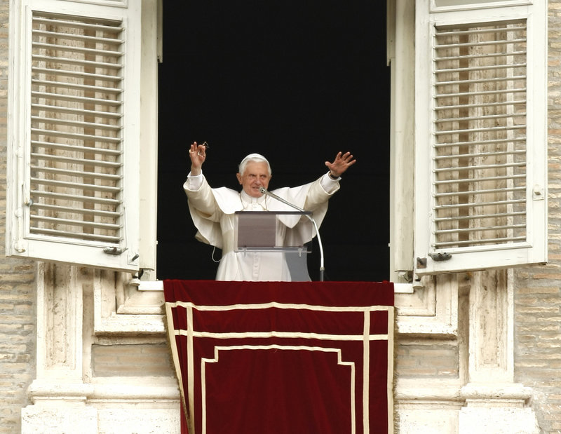 "Pope Benedict XVI offers a blessing from the window of his studio overlooking St. Peter's Square, at the Vatican on Sunday. An estimated 150,000 people filled St. Peter's Square in a show of support for the pope over the clerical sex abuse scandal, the Vatican said. Benedict said he was comforted by a ""beautiful and spontaneous show of faith and solidarity."""