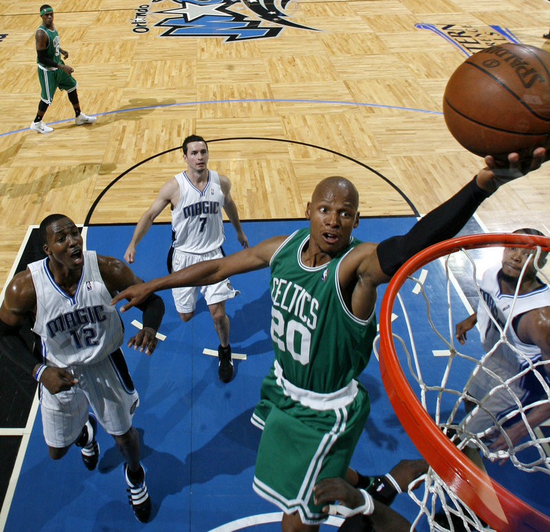 Ray Allen of the Celtics lays in a shot during the first half on Sunday in Orlando, Fla. Allen had 25 points as the Celtics held off the Magic to win the opener in the Eastern Conference finals.
