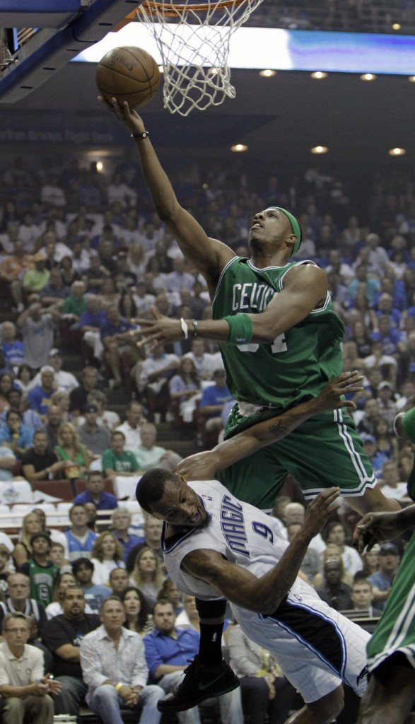 Paul Pierce of the Celtics is called for an offensive foul as he knocks Rashard Lewis of the Magic to the floor while driving to the basket on Sunday afternoon.