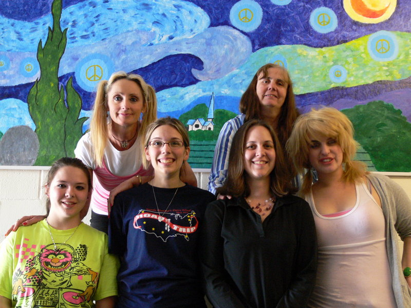 Lake Region arts show participants include, from left, front, Onyx Greenlaw, Angel Beek, visual arts instructor Erin White, Ashley McGinn, and rear, dance instructor Carmel Collins and visual arts instructor Chris Beal.