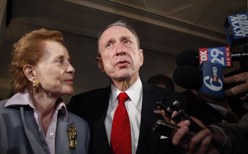 Five-term Sen. Arlen Specter, D-Pa., stands with his wife, Joan, before they voted Tuesday in Philadelphia. Specter lost the primary to Rep. Joe Sestak, whose calling card was a TV ad emphasizing Specter's change in party affiliation.