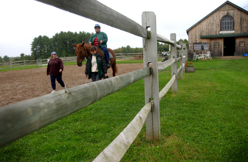Equest Therapeutic Riding Center is holding an orientation training for potential volunteers on May 26. Sidewalkers, shown here on the ground, do not need previous experience but do need to be in fairly good shape.