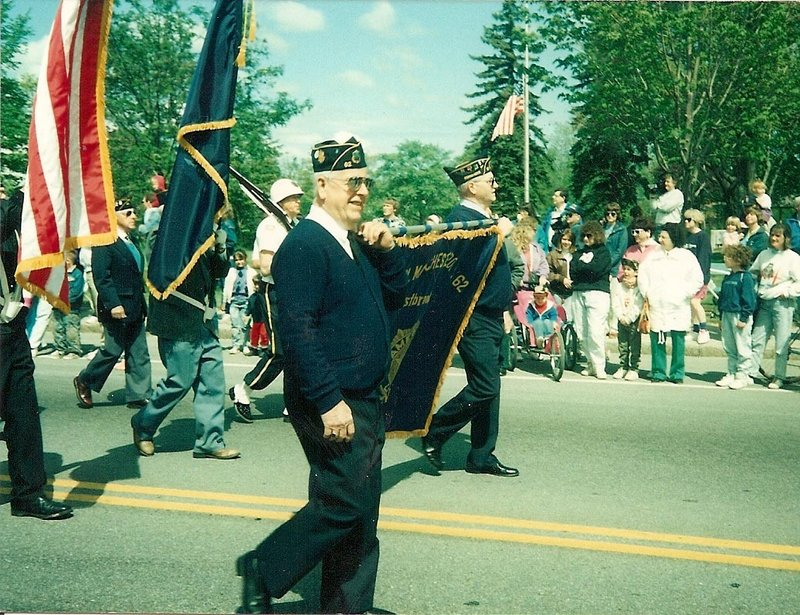 "Ronald Kenney, pictured marching as a member of the American Legion in one of many parades he was in, was considered the ""family hero,"" his daughter said."