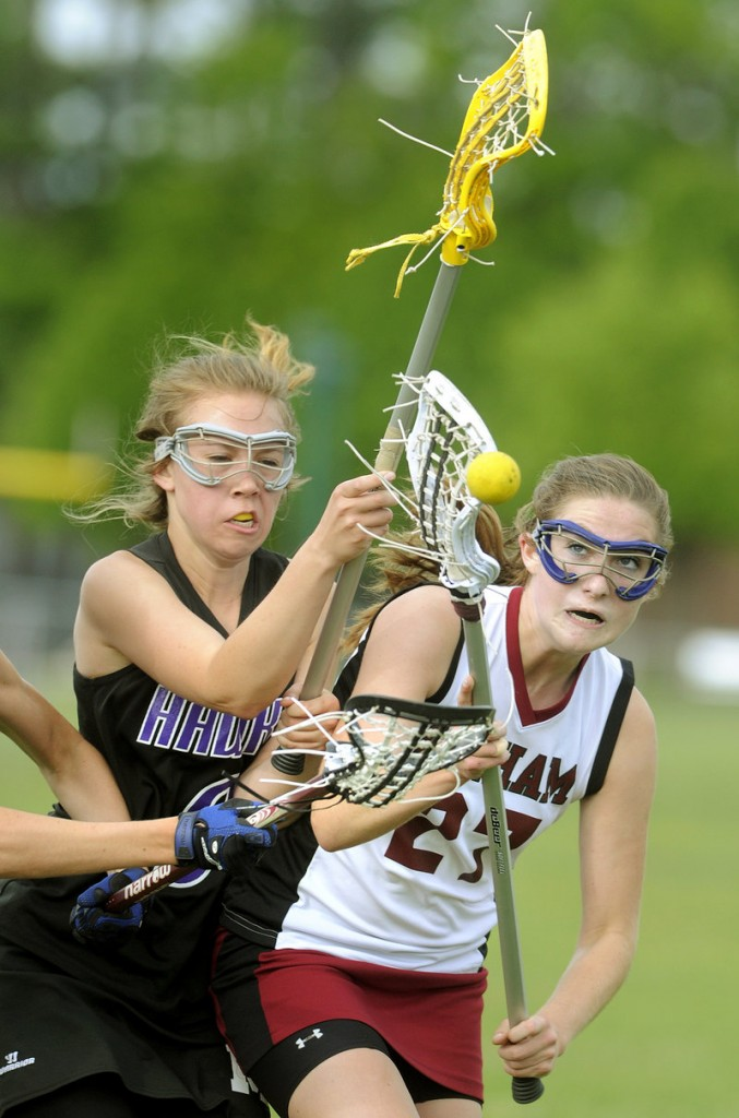 Marshwood's Erika Philbrick, left, defends as Gorham's Lindsay Smith tries to hold onto the ball in their lacrosse game Tuesday at Gorham. The unbeaten Rams won, 13-4.