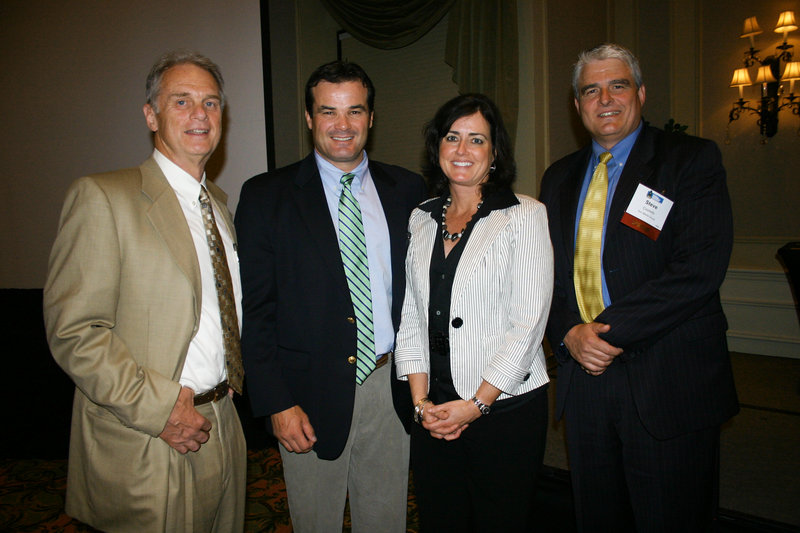 Tom Juenemann, director of the Institute for Family-Owned Business, which sponsored the event, David Wedge, Maureen Costello Wedge, board chair and a member of Sun Media Group, and Steve Costello of Sun Media Group.