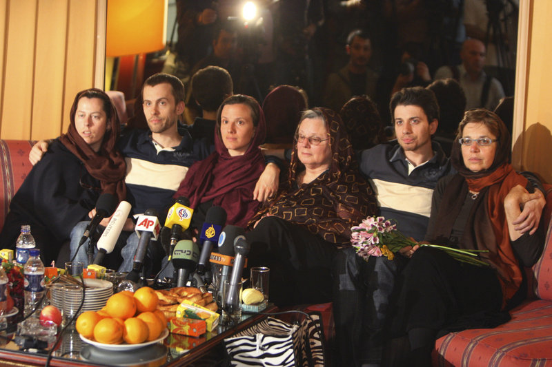 From the right: Laura Fattal and her son Josh, Nora Shourd and her daughter Sarah, and Shane Bauer and his mother Cindy Hickey sit together during a press briefing at the Esteghlal hotel in Tehran, Iran, Thursday. The three Americans, jailed in Iran for 10 months on charges of spying and entering the country illegally, hugged and kissed their mothers in an emotional reunion after the women arrived on a mission to secure their release.