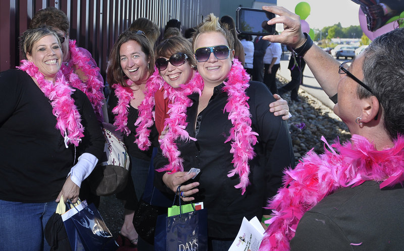 """Lisa Gorney, Anne Sleeman, Amanda Bailey and Kelly Briggette smile for the camera as Donna Galluzzo takes the photo of her friends before they entered the Dash of Diva event in Saco at Cinemagic's opening night of """"Sex in the City 2."""" The women were first in line."""