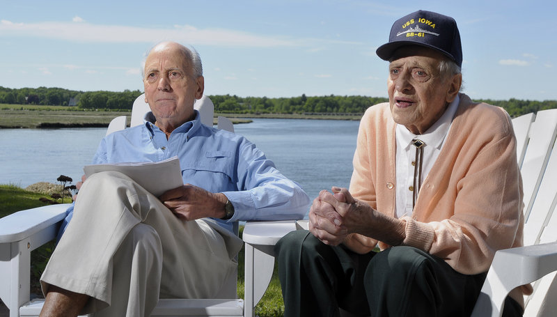 B.J. Palanza, left, and his brother John sit by the Nonesuch River in Scarborough on Friday and talk about their brothers, Tony and Sam. Tony Palanza died in a kamikaze attack in April 1945. His older brother Sam, who died three months ago, asked that his ashes be scattered at the site.