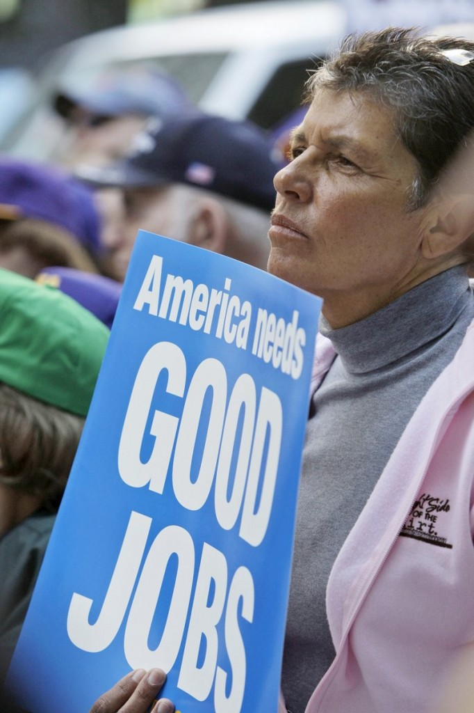 Ann Converso, of Buffalo, N,Y., joins a protest calling attention to unemployment during a rally in New York in late April. Currently, Congress is working on a bill to extend jobless benefits.