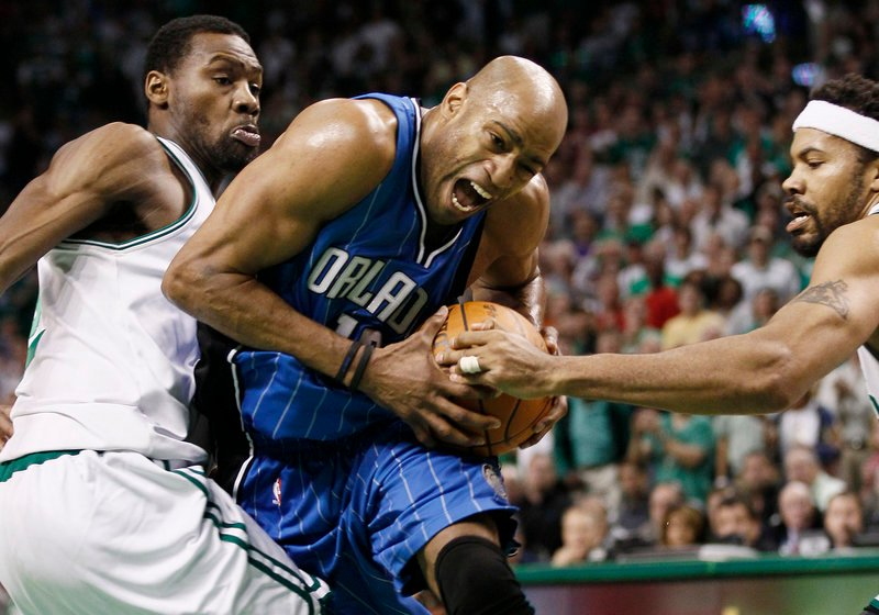 Vince Carter of the Orlando Magic tries to drive between Tony Allen, left, and Rasheed Wallace of the Boston Celtics during the Celtics' 96-84 victory Friday night in Game 6.