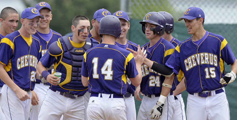 Jack Bushey of Cheverus is welcomed by teammates Saturday after hitting a home run to lead off the second inning of a 4-1 victory against Biddeford. Cheverus scored three runs in the first and held off Biddeford in a game between teams competing for a playoff berth in Western Class A.