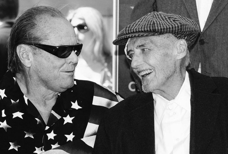 Actor Jack Nicholson, left, congratulates Dennis Hopper after Hopper was honored with a star on the Hollywood Walk of Fame in Los Angeles in March. Hopper died Saturday at his Venice, Calif., home, surrounded by family and friends.