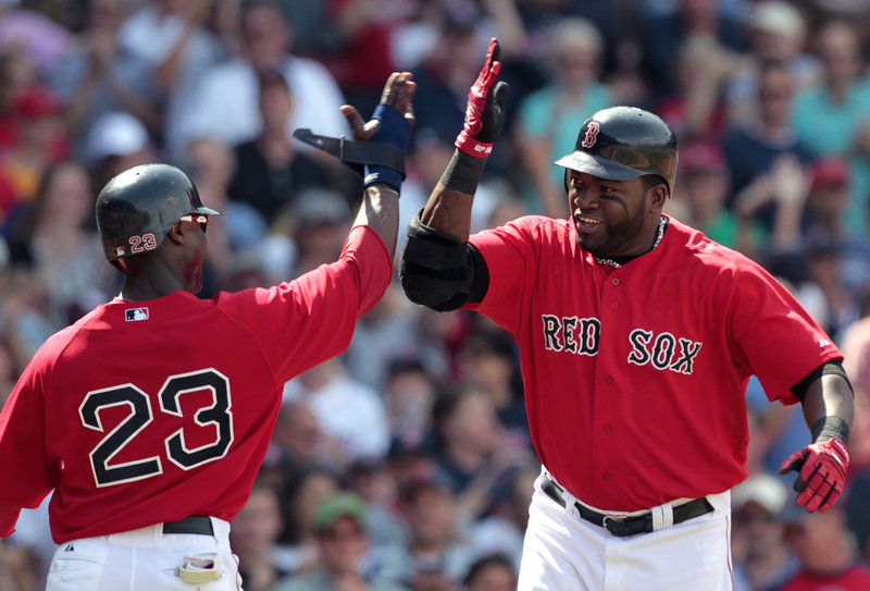 Boston's Mike Cameron, left, congratulates David Ortiz on his two-run homer that brought home Cameron in the fifth inning Sunday against the Royals at Fenway Park. The Red Sox won 8-1 to earn a split of the four-game series.