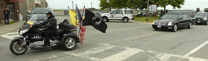Staff photo by Joe Phelan A group of Patriot Guard Riders was part of the motorcade accompanying the hearse carrying U.S. Army Spc. Wade A. Slack's remains Friday morning from the Augusta State Airport on the drive north to Waterville. sidney