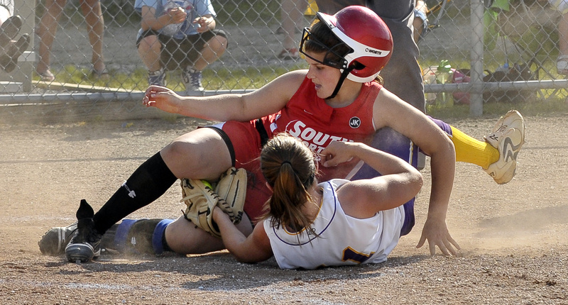 Cheverus pitcher Theresa Hendrix holds onto the ball Wednesday while tagging out Brittany Harrison of South Portland, who was attempting to score a second run on a ball that rolled away. South Portland took advantage of Cheverus' faulty defense to earn a 10-6 victory.