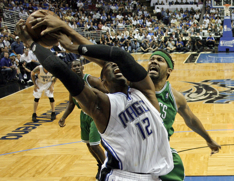 Dwight Howard of the Orlando Magic has a shot blocked by Rasheed Wallace of the Boston Celtics during Orlando's 113-92 victory Wednesday night in Game 5 at home.