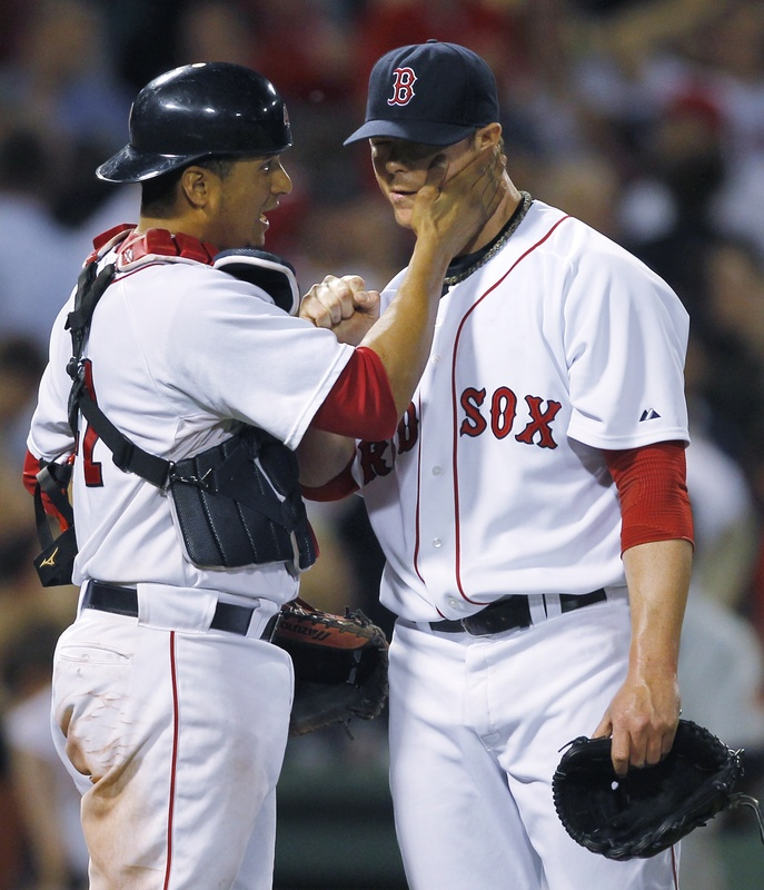 Boston catcher Victor Martinez gives pitcher Jon Lester a pat on the cheek after a 6-2 win over the Twins at Fenway Park. Lester allowed one earned run on six hits.
