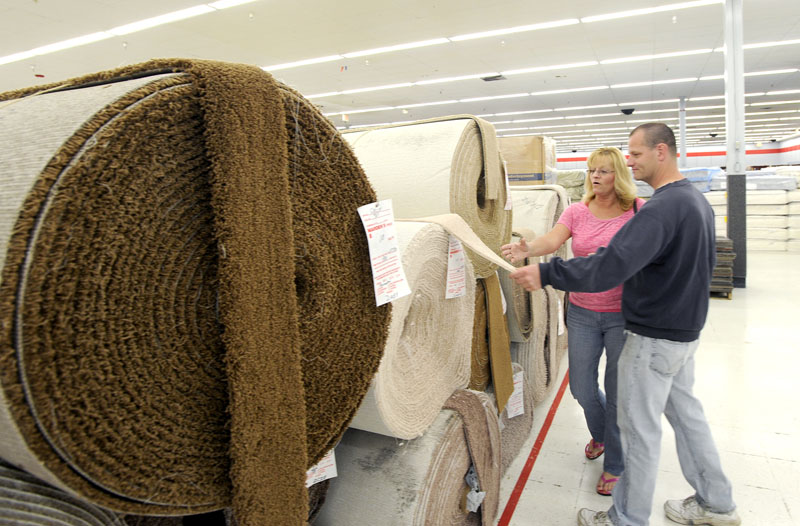Dawn and Ed Estey from Standish shop for carpet as Mardens opens a large store in Scarborough.