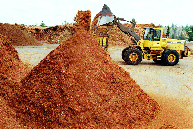 Piles of mulch at P.R. Russell Inc. in Richmond, which supplies different types of mulch throughout New England.