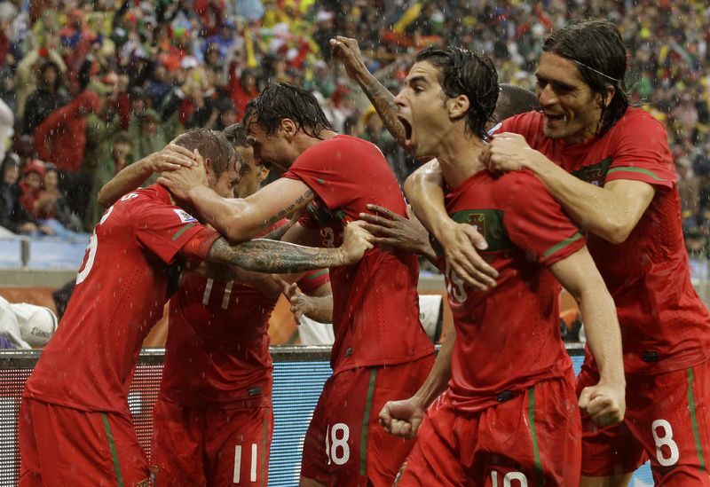 Raul Meireles, left, celebrates with his Portuguese teammates after scoring a first-half goal Monday against North Korea. Portugal added six more goals in the second half, all but guaranteeing advancement to the second round.