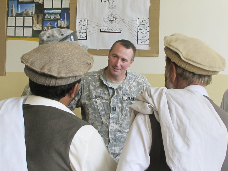 """Capt. Paul Bosse of Auburn, a Maine Army National Guard commander, listens to requests for help during Monday's weekly """"shura,"""" or meeting, with local Afghan elders at the District Center in Dand wa Patan, Afghanistan."""