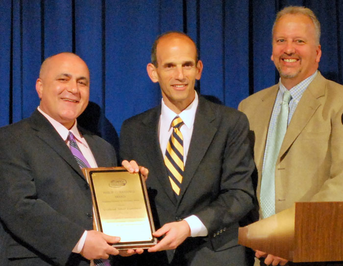 Westbrook Superintendent Reza Namin, left, Gov. John Baldacci and John Brautigam, director of Efficiency Maine