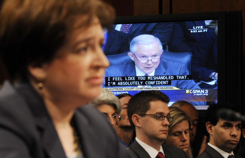 Supreme Court nominee Elena Kagan, foreground. listens to questions from Sen. Jeff Sessions, R-Ala., the ranking Republican on the Senate Judiciary Committee, on video screen, on Capitol Hill today during the confirmation hearing for Kagan.