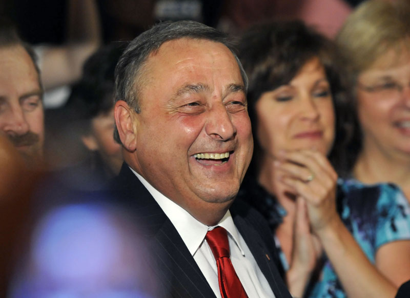 Maine GOP gubernatorial candidate Paul LePage celebrates with supporters at campaign headquarters in Waterville Tuesday night.