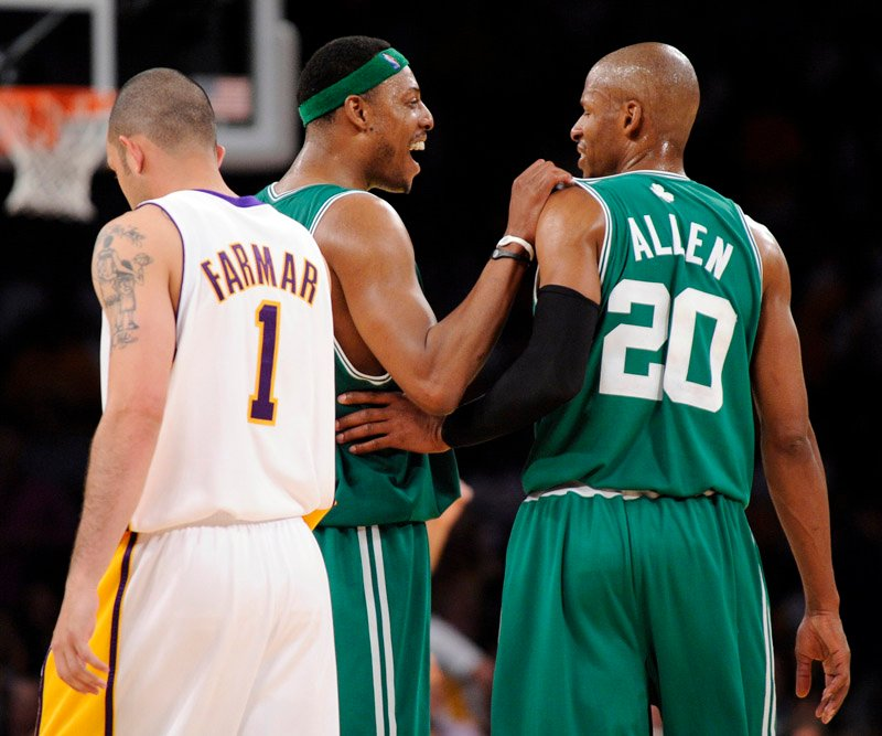 Boston Celtics guard Ray Allen (20) reacts with Paul Pierce (34) as Los Angeles Lakers guard Jordan Farmar walks by late in the second half of Game 2 of the NBA basketball finals Sunday in Los Angeles. The Celtics won 103-94.