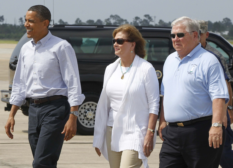 President Barack Obama walks with Mississippi Gov. Haley Barbour, right, and his wife Marsha, center, after arriving on Air Force One at Gulfport BIloxi Airport in Gulfport, Miss., today.