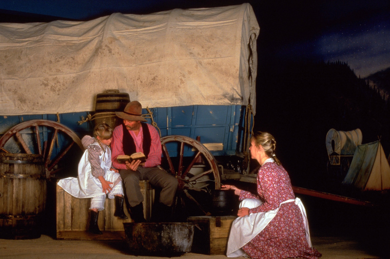 Actors perform a re-enactment at the Oregon Trail Interpretive Center outside of Baker City, Ore.