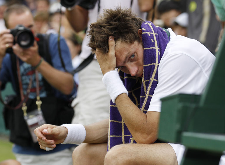France's Nicolas Mahut sits in his chair courtside following his loss to John Isner.