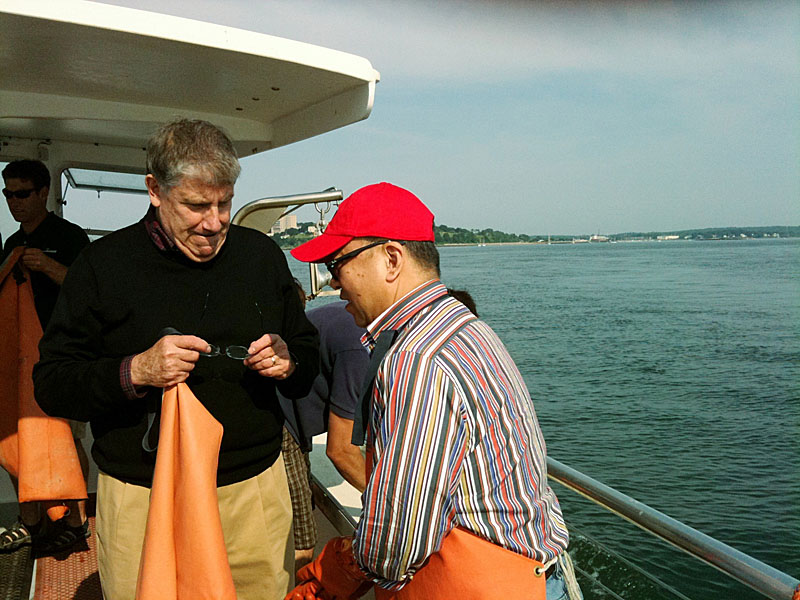 Eliot Cutler, independent candidate for governor, talks with Fenglei Fang, a businessman from Beijing while on a lobster boat in Portland Harbor today.