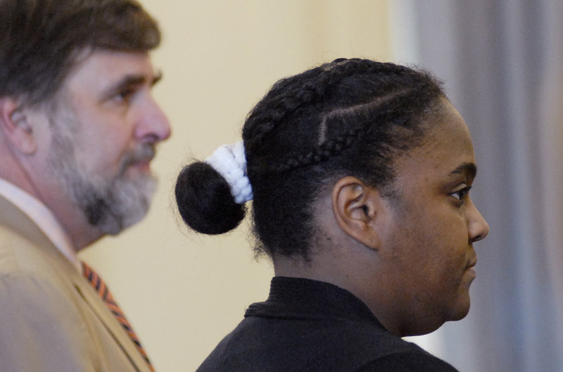 Darlene George listens as the jury returns a guilty of murder verdict against her at York County Superior Court today.