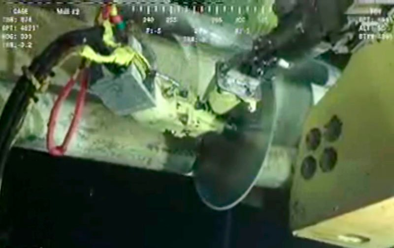 In this image made from video released by British Petroleum, robot submarines use a diamond-edged, circular saw-like device to make a clean cut above the blowout preventer at the Deepwater Horizon oil rig today. The company then will lower a cap over it with a rubber seal.