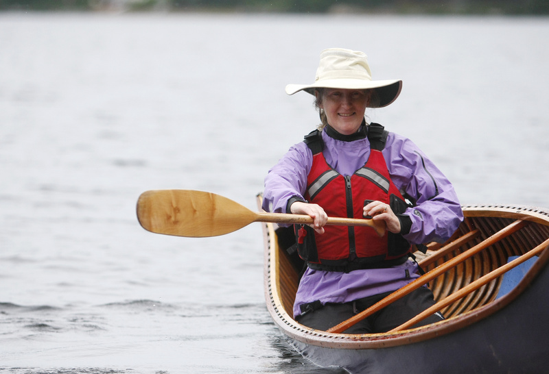 Becky Mason demonstrates proper stroke during an introduction to solo paddling class at the Maine Canoe Symposium last weekend at Winona Camps in Bridgton.