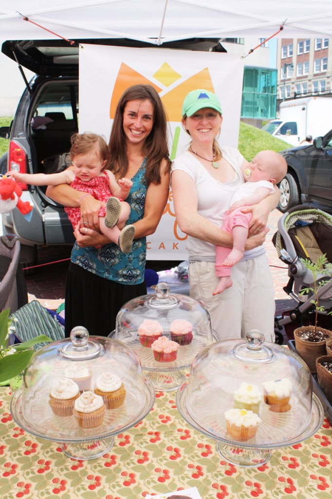 Stephanie O'Neil, right, organized the market. She runs Tulips Cupcakery & Farm and is shown here holding her daughter Autumn O'Neil and standing next to her friend Jenny Carrigan and her daughter Colby Davis.