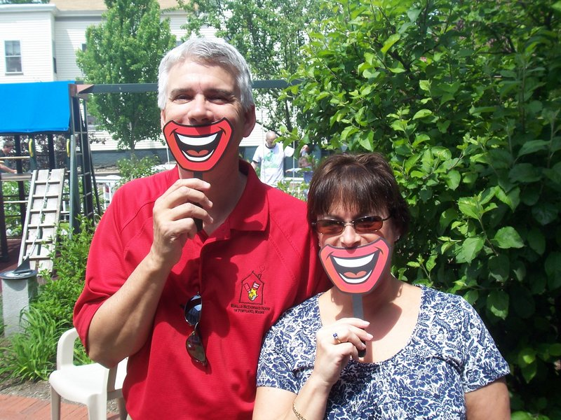 Robert and Nancy Horne, longtime volunteers, pose with Ronald McDonald smiles during the 15th anniversary celebration of the Ronald McDonald House in Portland.