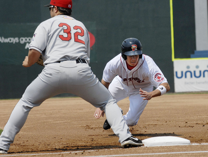 Nate Spears dives back to first base on a pickoff attempt. Spears started a six-run seventh inning with a home run, helping the Sea Dogs overcome a 6-2 deficit.