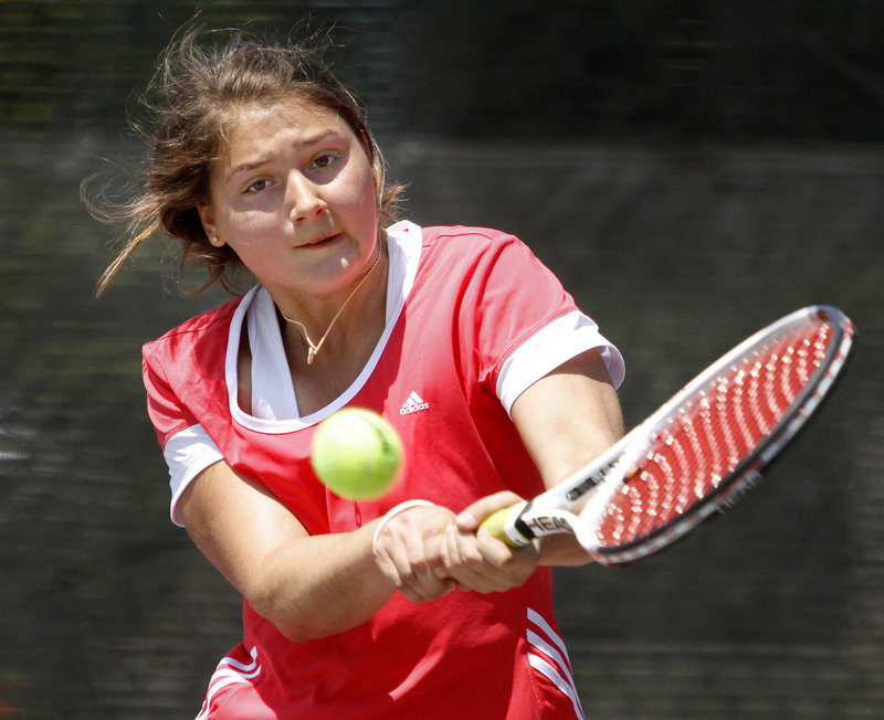 Elena Mandzhukova, an exchange student from Portugal who plays for Brunswick, returns a shot Monday during her 6-4, 7-6 (4) win over Falmouth's Analise Kump in the girls' singles state final.