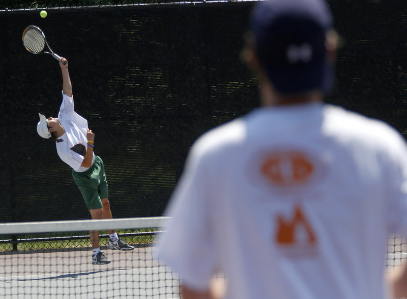 Brandon Thompson serves to Patrick Ordway during the boys' championship match at Bates College. Thompson, a junior, broke through to win the title after finishing second to Mt. Ararat's Mike Hill last year.
