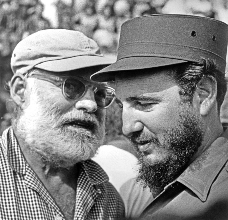 Ernest Hemingway talking to Fidel Castro in an undated photo.