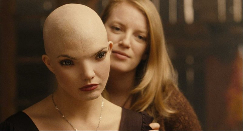 "Warner Bros. Delphine Chaneac, left, as the newly created organism Dren and Sarah Polley as the scientist Elsa in the sci-fi thriler ""Splice."""