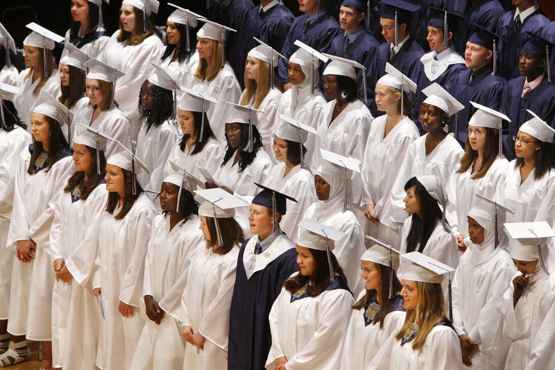 Portland High School seniors sing during their graduation ceremony at Merrill Audiorium in Portland on Wednesday.