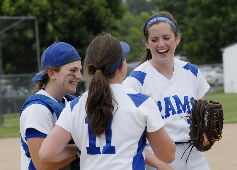 From left, Janelle Bouchard, Hannah King and Kelly King celebrate after completing the regular season Wednesday with a 3-2 victory over Biddeford.