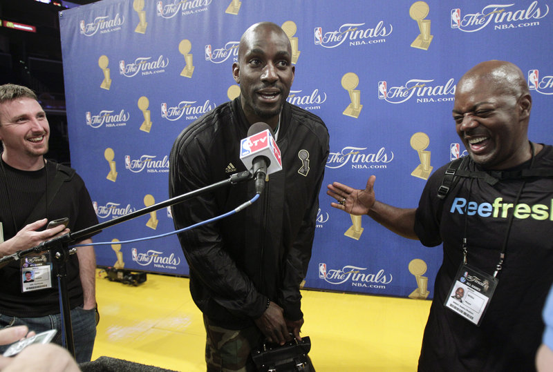 Kevin Garnett, center, jokes with the media Wednesday while discussing his role for the Boston Celtics in the NBA championship series against the Los Angeles Lakers.