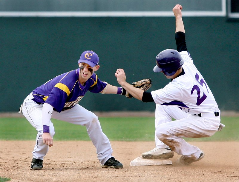 Nick Colucci of Deering avoids a tag by Nick Melville of Cheverus and steals second base Wednesday during their Telegram League game at Hadlock Field. Deering, the defending state champion, won 3-0 and will enter the Western Class A playoffs next week as the top seed.