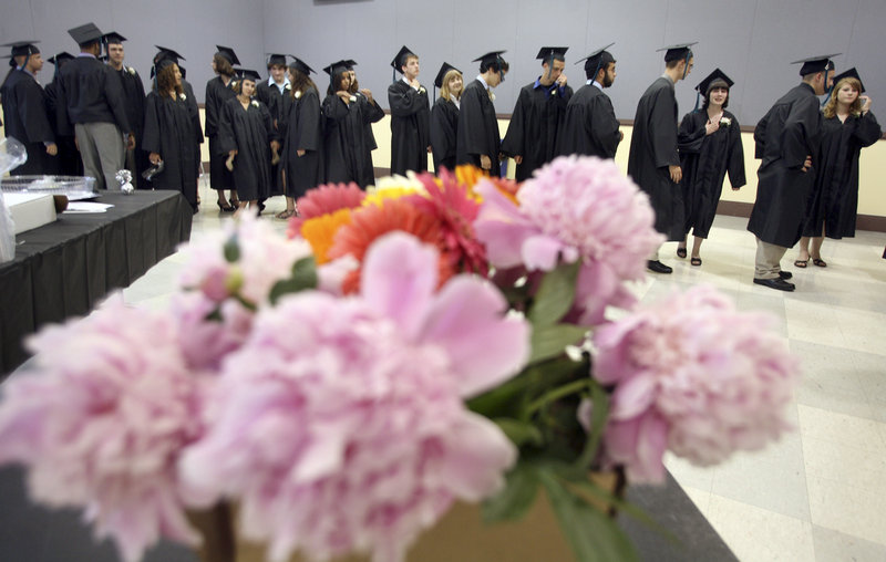 Casco Bay High School seniors line up before the start of their graduation Wednesday at Merrill Auditorium in Portland.
